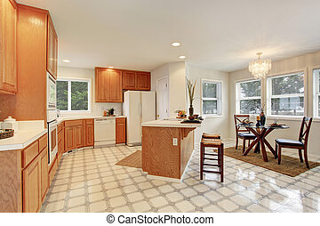 Complete kitchen with tile floor.