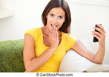 Surprised young woman covering her mouth - Surprised young...
