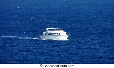 Motor boat on a background of blue sea