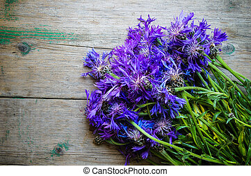 cornflowers on the old wooden table, rustic
