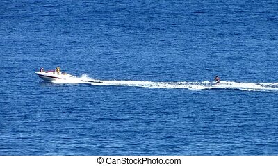 Water Skiing - Motor boat and Water Skiing on the sea