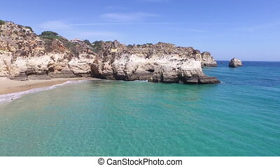 Aerial from natural rocks at Praia Tres Irmaos in Alvor...