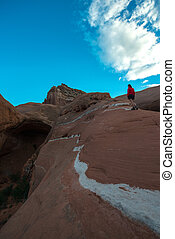 Woman walking on a slickrock Cave Point Escalante Utah -...