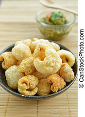 Pork rinds also known as chicharon or chicharrones, deep...
