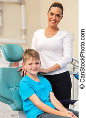 mother and her son in dentists office - portrait of...