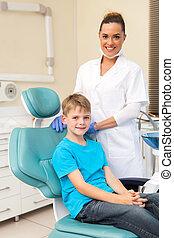 little boy sitting on dentist chair - handsome little boy...