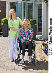 Portrait of Nurse with Senior Woman in Wheelchair - Portrait...