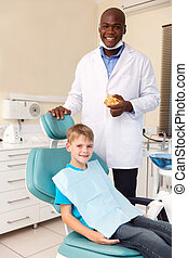 little boy and african american dentist
