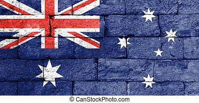 Flag of Australia on old brick wall.