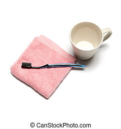 tooth brush and towel with mug