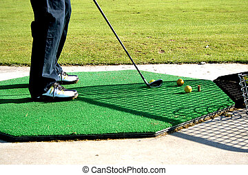 Golf - A golf club driver about to strike a golf ball on a...