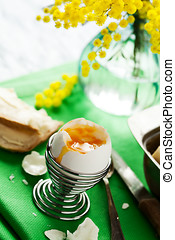 Egg - Breakfast setting with open soft boiled egg in egg cup