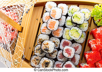 Sushi set in the wooden ship