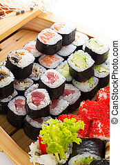 Sushi set in the wooden ship.