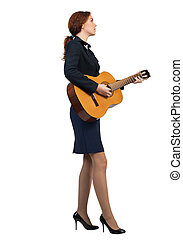 Businesswoman with guitar - Cheerful businesswoman playing...