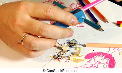 pencils sharpening part 2 - close-up Hands sharpening a...