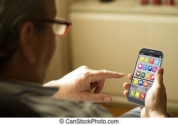 Portrait of a mature man with a mobile phone - technology...