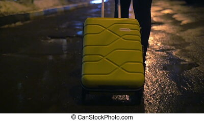 Walking alone with trolley bag at night - Steadicam back and...