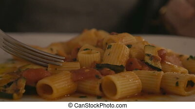 Eating delicious pasta dish