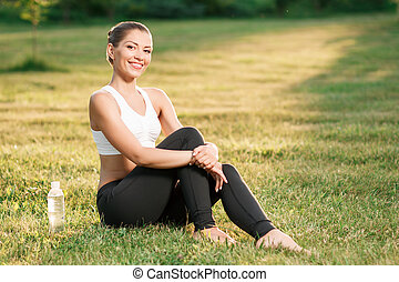 Young nice lady relaxing on grass - Time for relax. Sanguine...