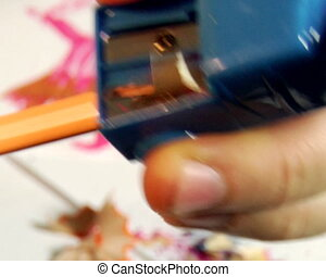 pencils sharpening - close-up Hands sharpening a pencil with...