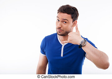 Attractive young guy is gesturing positively and nicely -...