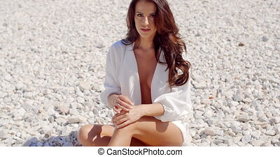 Portrait of Brunette Woman Sitting on Rocky Beach - Slow...