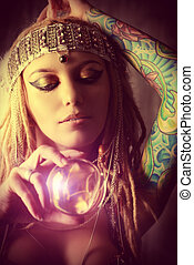 divination - Magnificent fortune teller holding crystal ball...