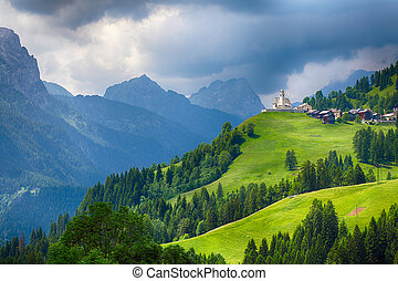 Church in Dolomites alps countryside meadow mountain