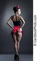 Rear view of sexy girl dressed in role-suit - Rear view of...