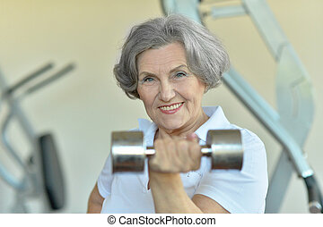 Happy fit senior woman exercising