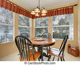 Simple dinning room with tile floor.