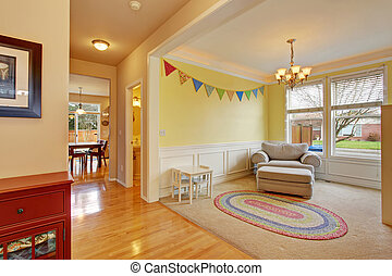 Cute kids play room with rug.