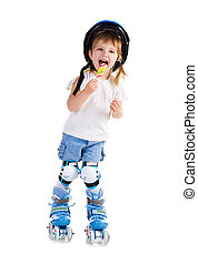 Little girl in roller skates with bon-bon. Studio shot