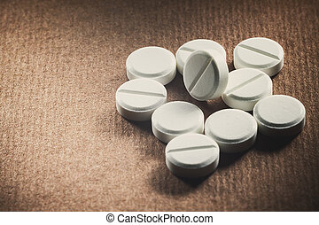 White Tablets - Macro view on white tablets, unpacked on...