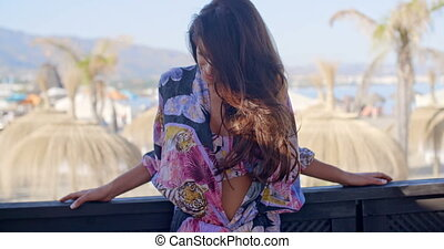 Brunette Woman in Bikini on Beach Resort Balcony - Waist Up...