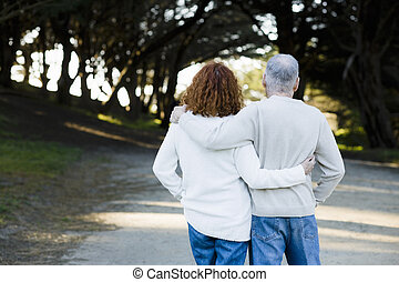 Couple Looking Down Path - Senior Couple With Backs to...