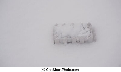 Decorative white wooden fence in the snow in winter close up...