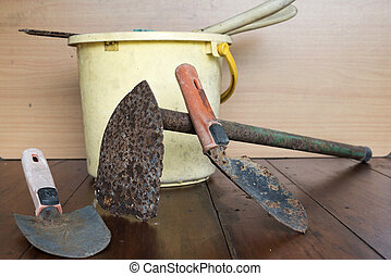 garden tools on wood background