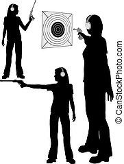 Silhouette woman shoots target pistol - A silhouette woman...