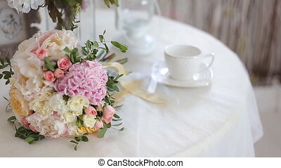 Wedding bouquet of pink roses and peony on table