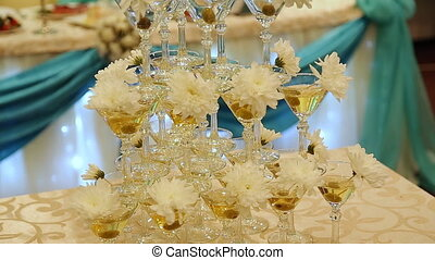 Pyramid champagne martini glasses at wedding