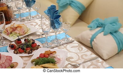 Served for a banquet table. Wine glasses with napkins,...