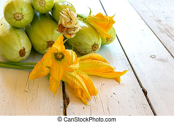 Courgettes - Bunch courgettes and courgettes flowers on a...