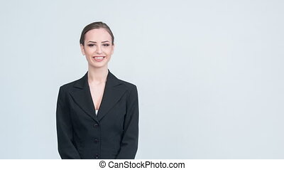 Woman in suit showing with her hand