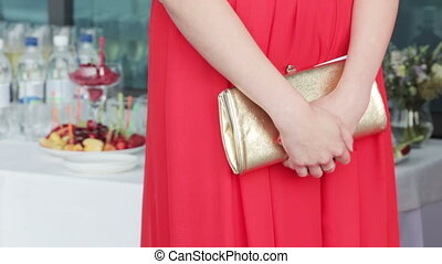 Klatch woman - Girl at a wedding reception held clutches