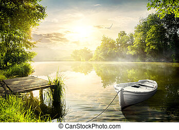 Boat on the bank of the river in the early morning