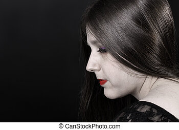 Woman with porcelain skin and shiny hair