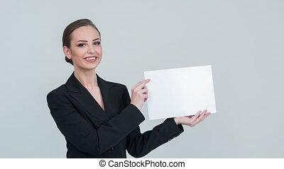 Lady pointing something on white paper