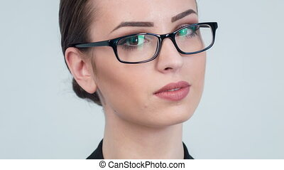Close-up of nice woman putting off her glasses